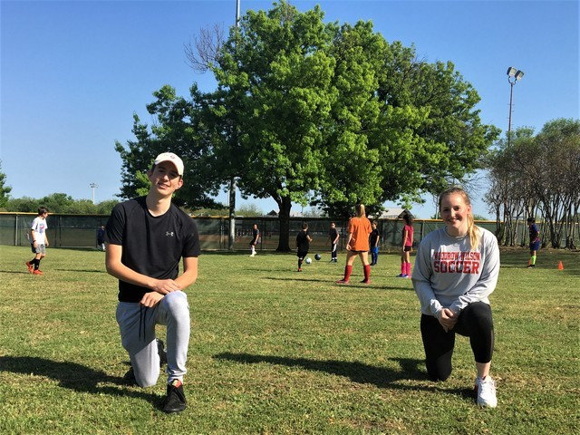 JL Long soccer alums visit practice
